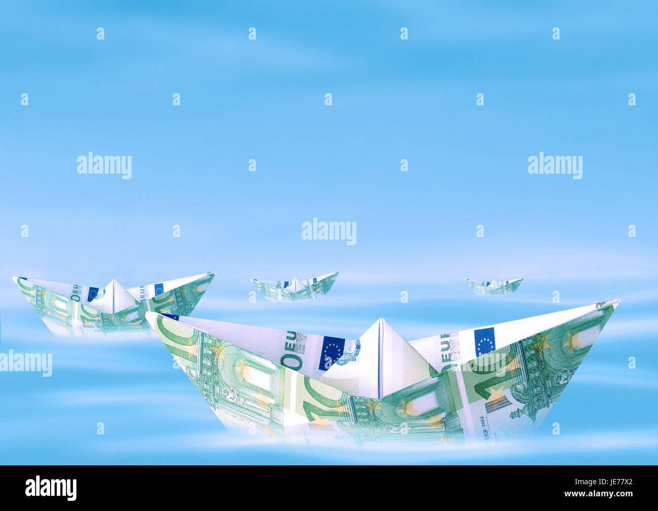Paper ships from euro of bank notes, Stock Photo