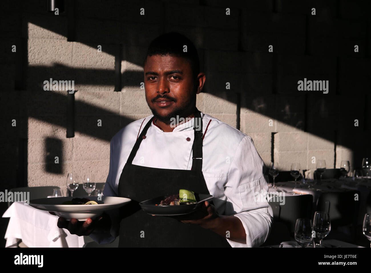 Athens, Greece. 22nd June, 2017. 25-year-old refugee chef Hassan from Somalia, works in 'Vassilenas', a - Stock Image
