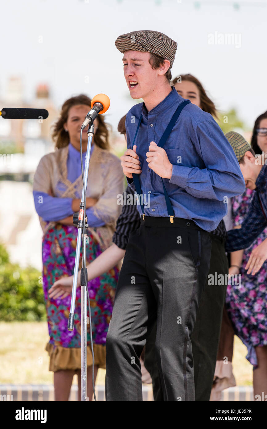 England, Broadstairs. teenage man, 16-17 years, singing in front of microphone in an open air production of 'My - Stock Image