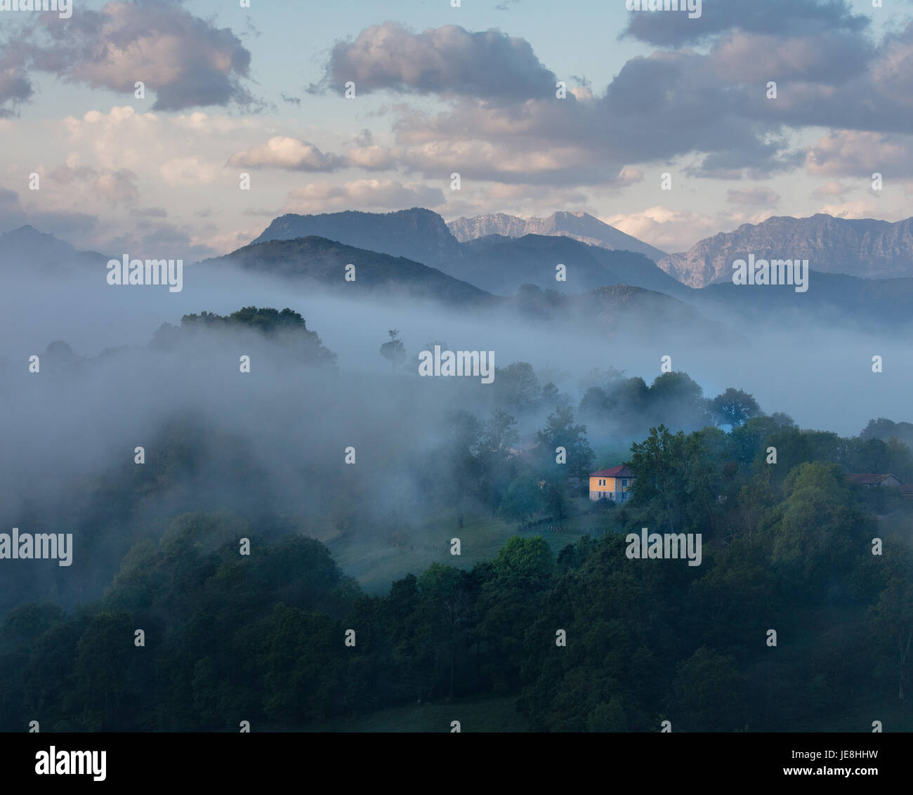 Clearing early morning mist in the western Picos de Europa in northern Spain near Ariondas - Stock Image