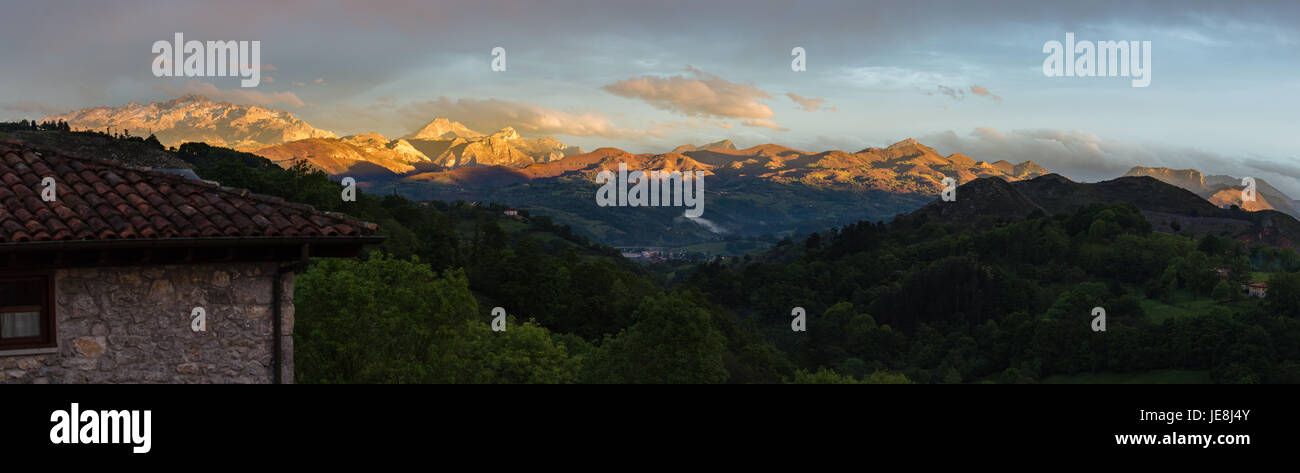 Sunset over the western peaks of the Picos de Europa in northern Spain from a hill above Ariondas - Stock Image