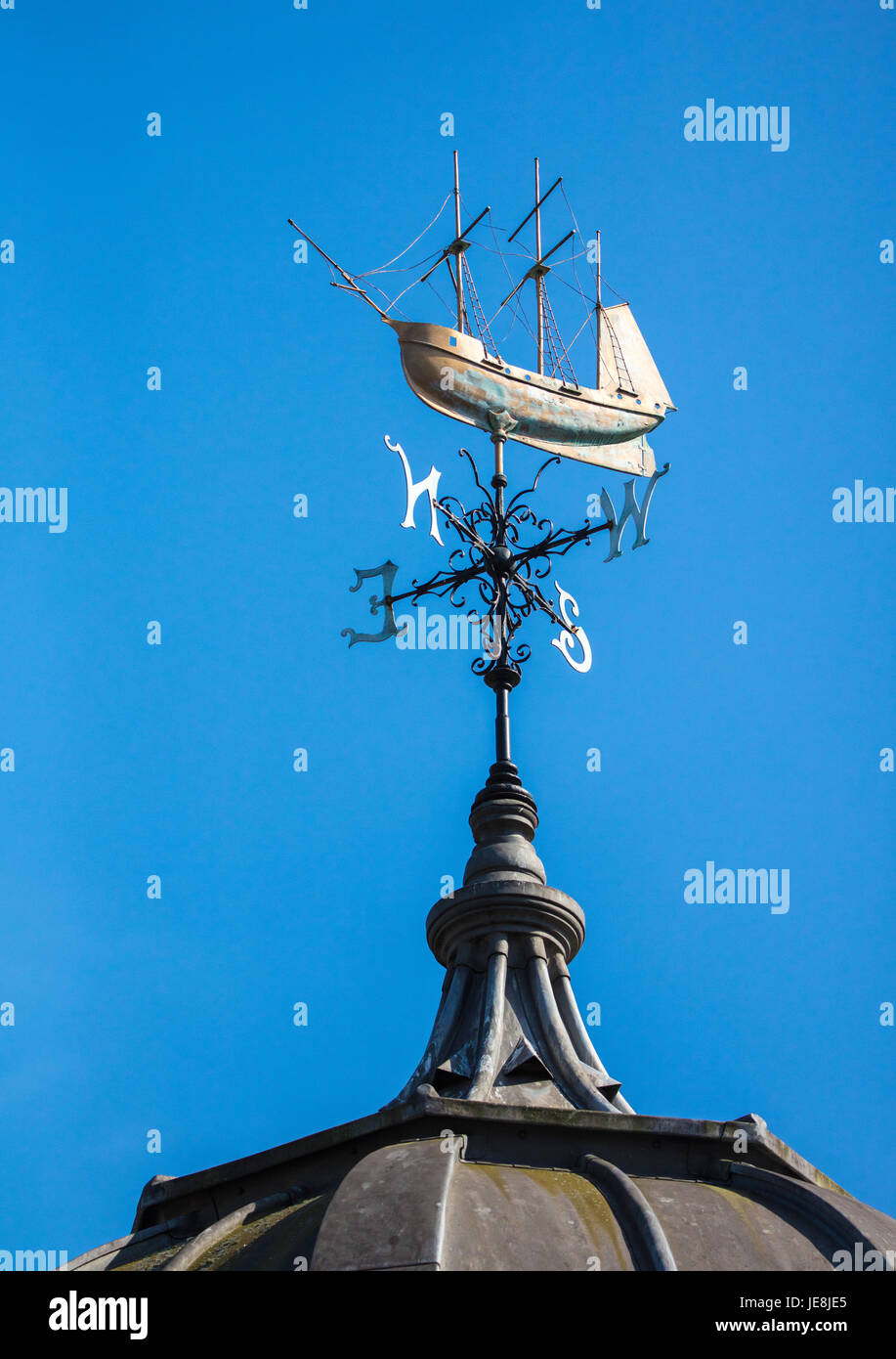 Weather vain in the form of a three masted galleon above the Watershed buildings in Bristol city centre UK - Stock Image