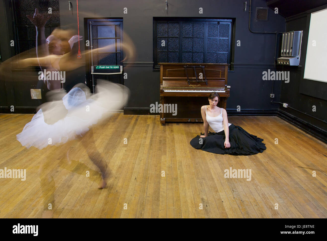 Two girl dancers n the dance studio with motion blur Stock Photo