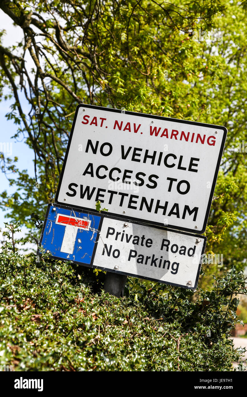A sign or warning notice for satellite navigation or sat nav users saying no vehicle access to Swettenham Cheshire - Stock Image