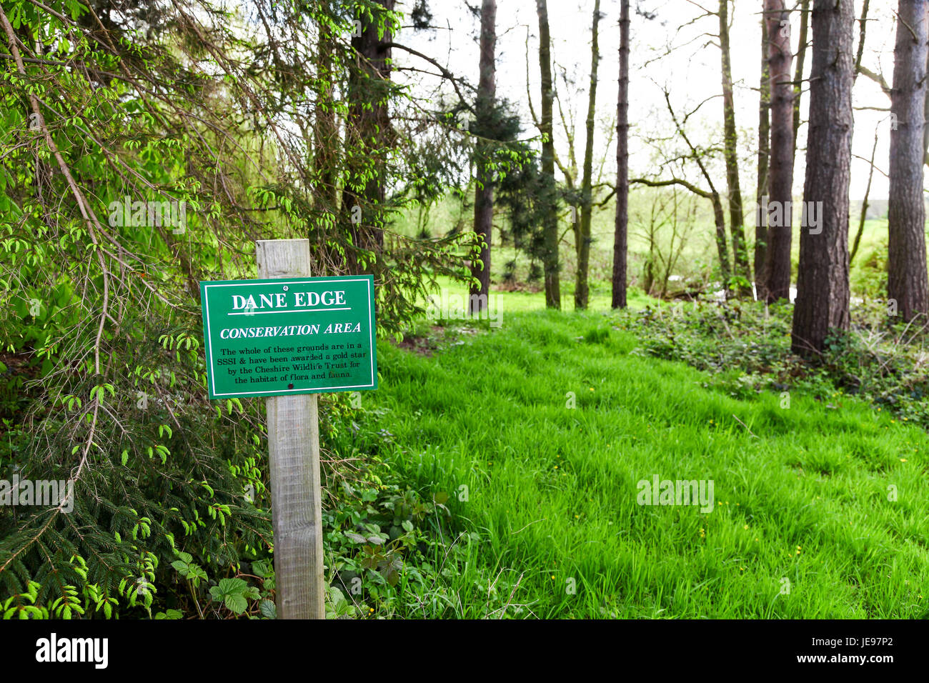 A sign at Dane Edge conservation area and Site of Special Scientific Interest or SSSI at Swettenham Cheshire England - Stock Image