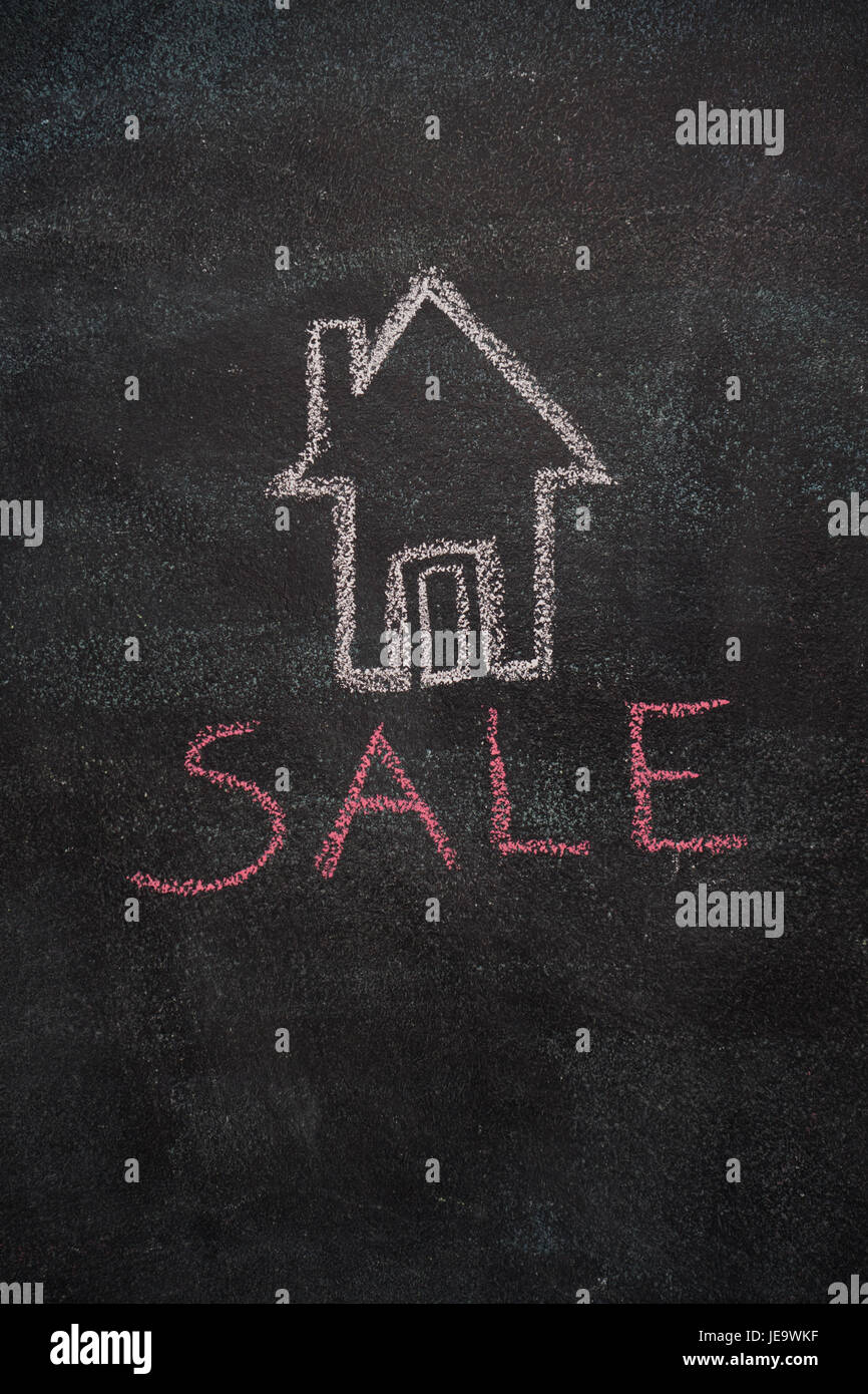 House with sale word drawn with chalk on blackboard - Stock Image