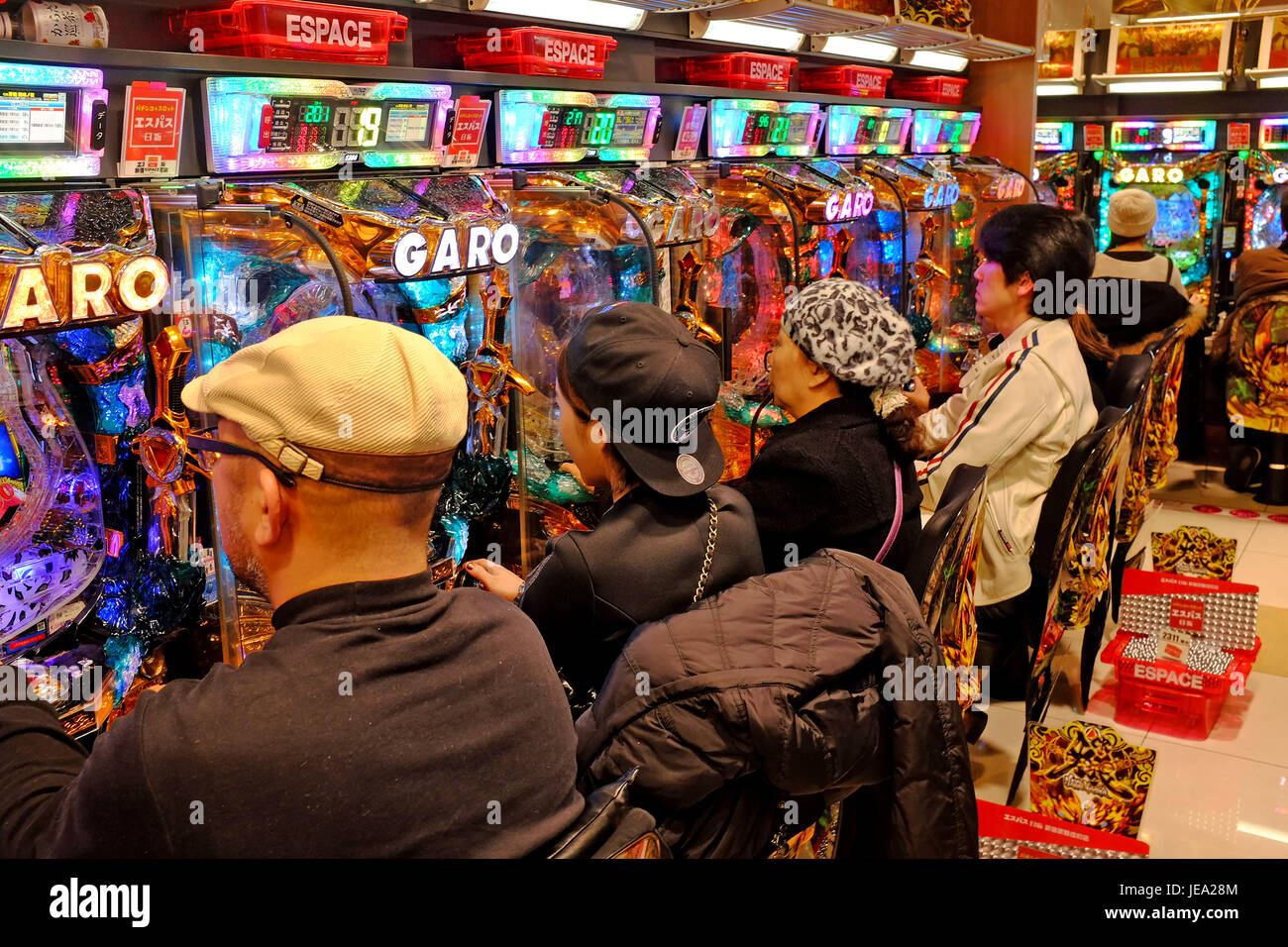 While gambling in Japan is technically illegal, patchinko parlors like the one pictured in Tokyo, Japan, offer a - Stock Image