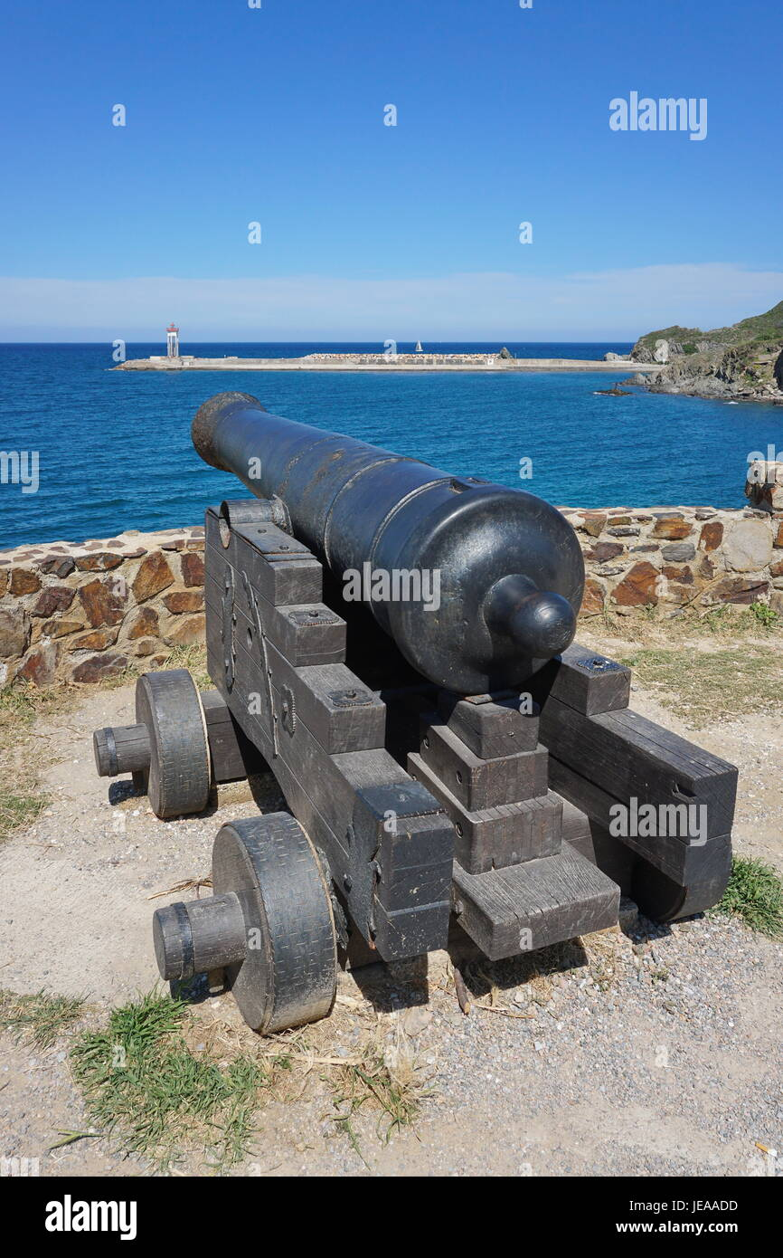 Old canon on the coast in the harbor of Port-Vendres, Mediterrean sea, Cote Vermeille, Roussillon, Pyrenees Orientales, - Stock Image