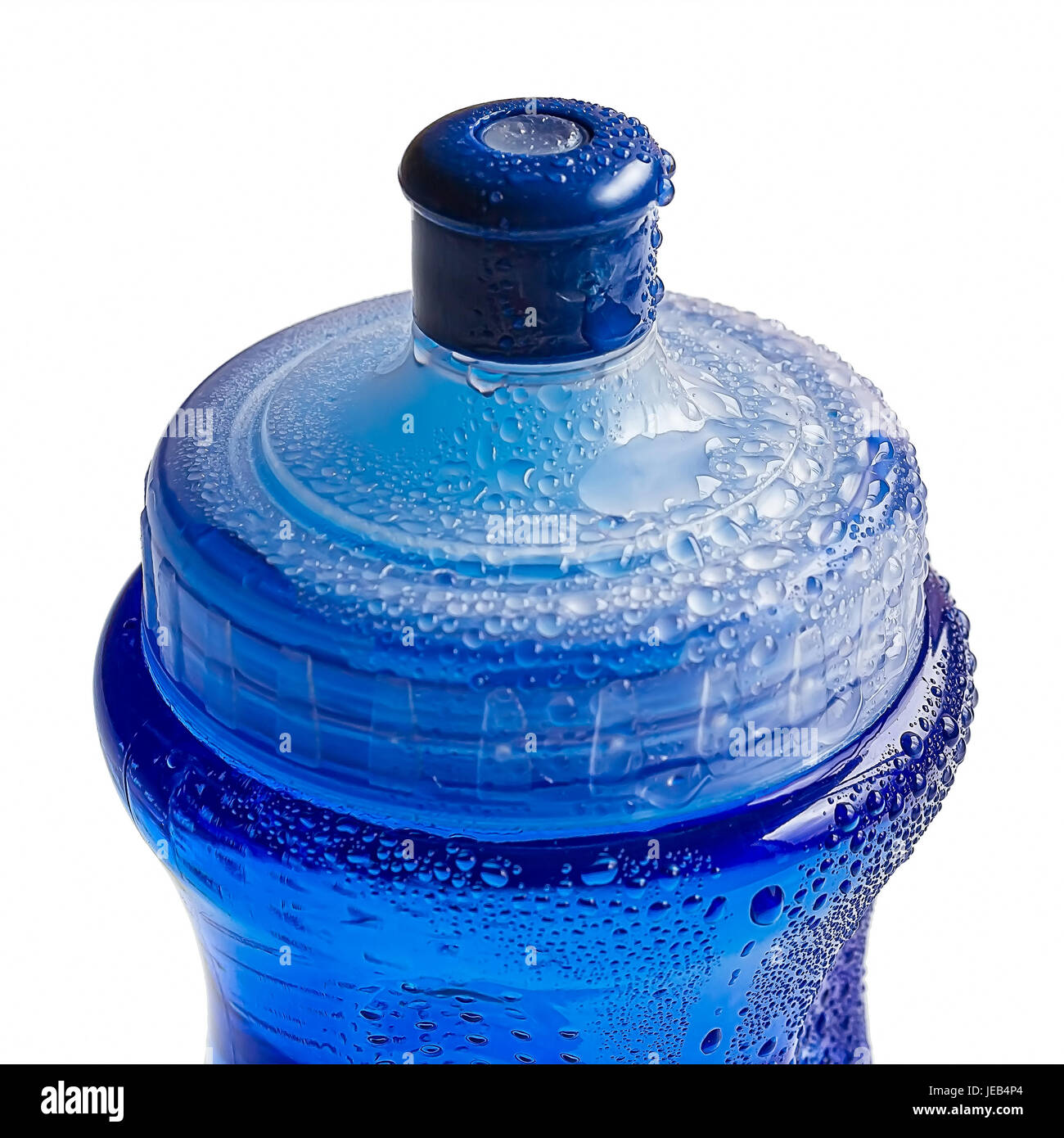 Blue plastic bottle with water drops on it - Stock Image