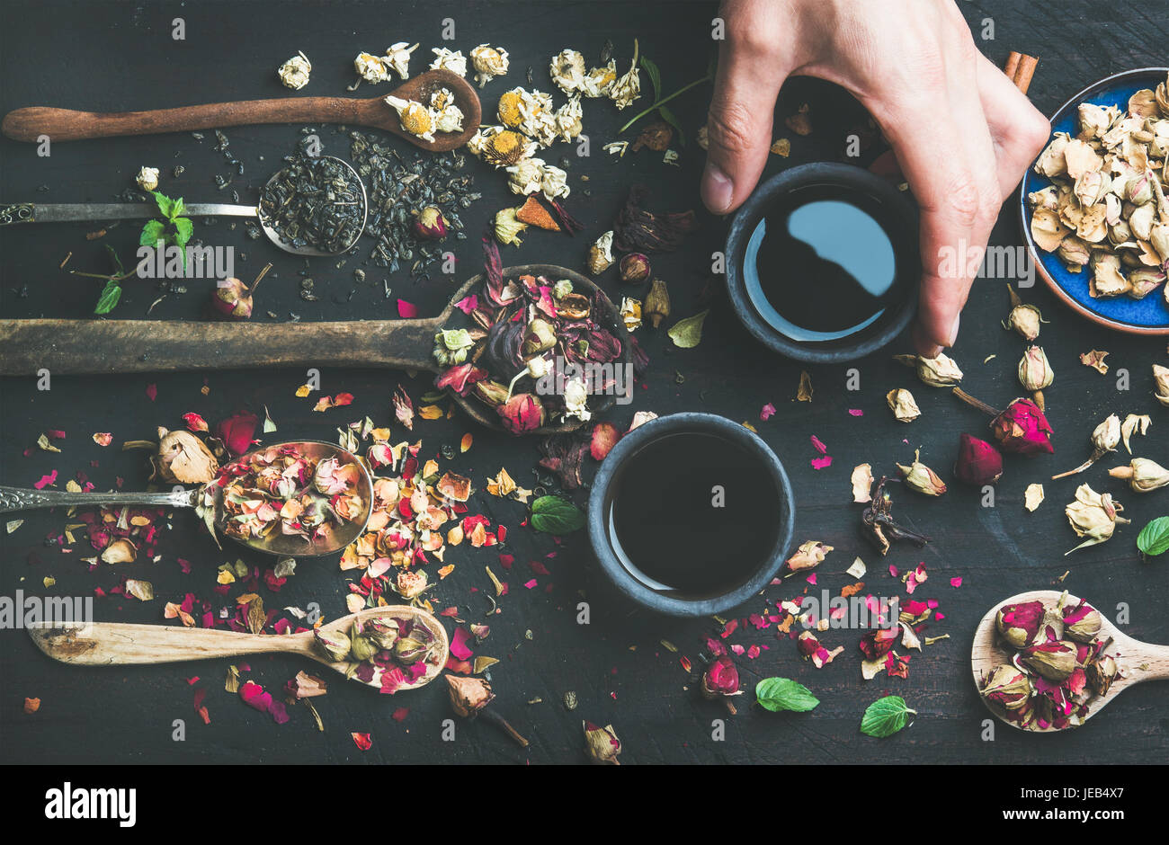 Chinese black tea in stoneware cups in man's hand - Stock Image