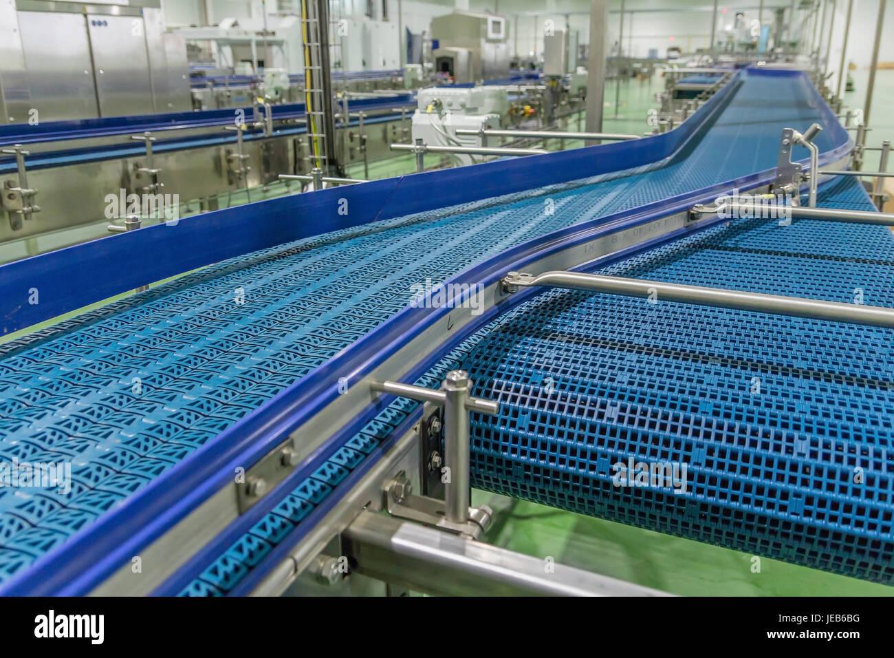 Empty conveyor belt of production line, part of industrial equipment - Stock Image