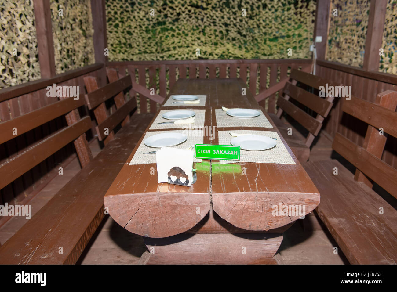 Enjoyable Wooden Table With Wooden Benches In The Gazebo And A Ibusinesslaw Wood Chair Design Ideas Ibusinesslaworg