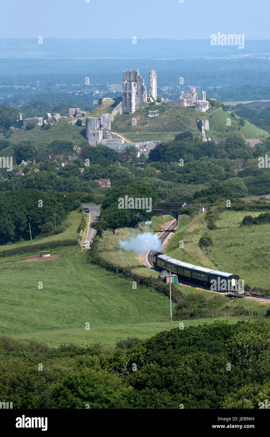 Steam train with a backdrop of Corfe Castle on the Swanage Railway in Dorset England UK. June 2017 - Stock Image