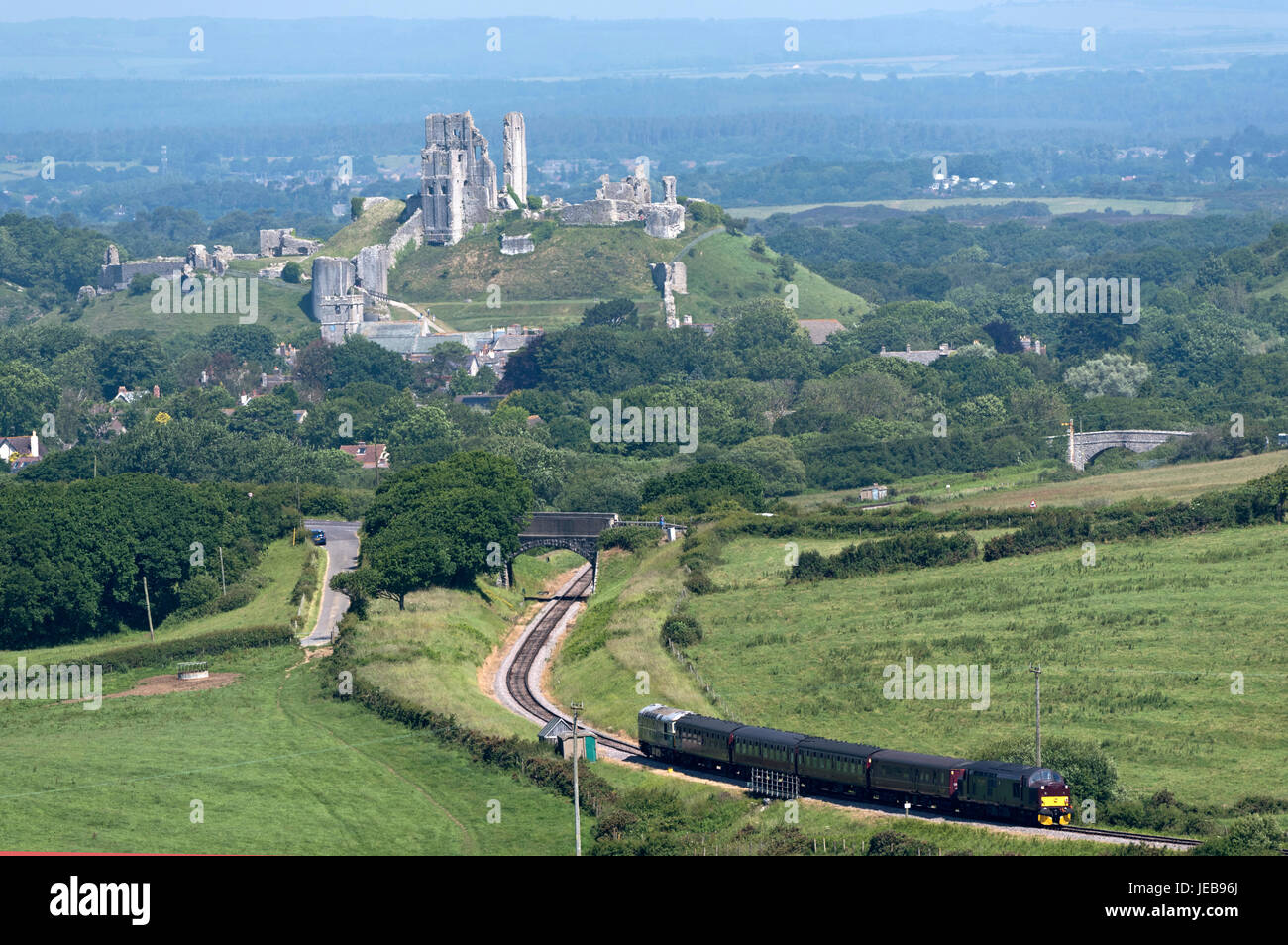 An old diesel train approaching Corfe Castle which provides an hourly service between Swanage to Wareham connecting - Stock Image