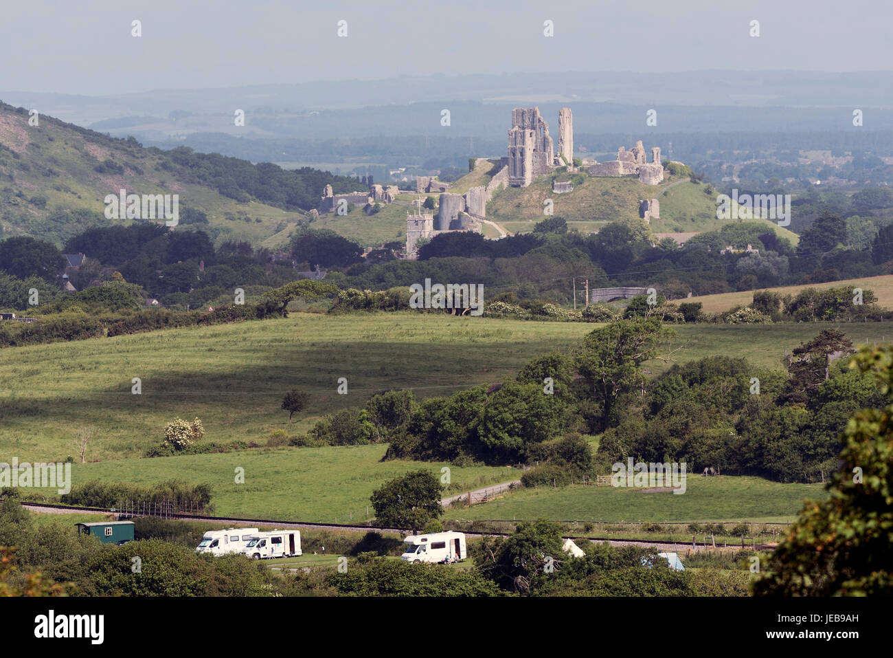Campsite with a backdrop of Corfe Castle in the Dorset countryside, Southern England UK. June 2017 - Stock Image