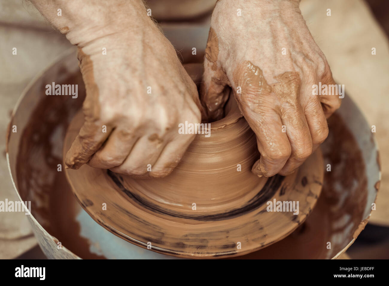 Close up of male craftsman working on potters wheel - Stock Image
