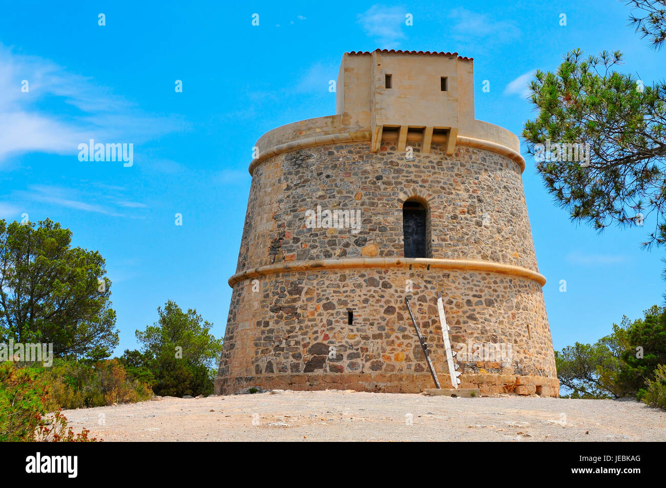 a view of the medieval tower Torre de Campanitx or Torre den Valls, in Ibiza, Spain - Stock Image