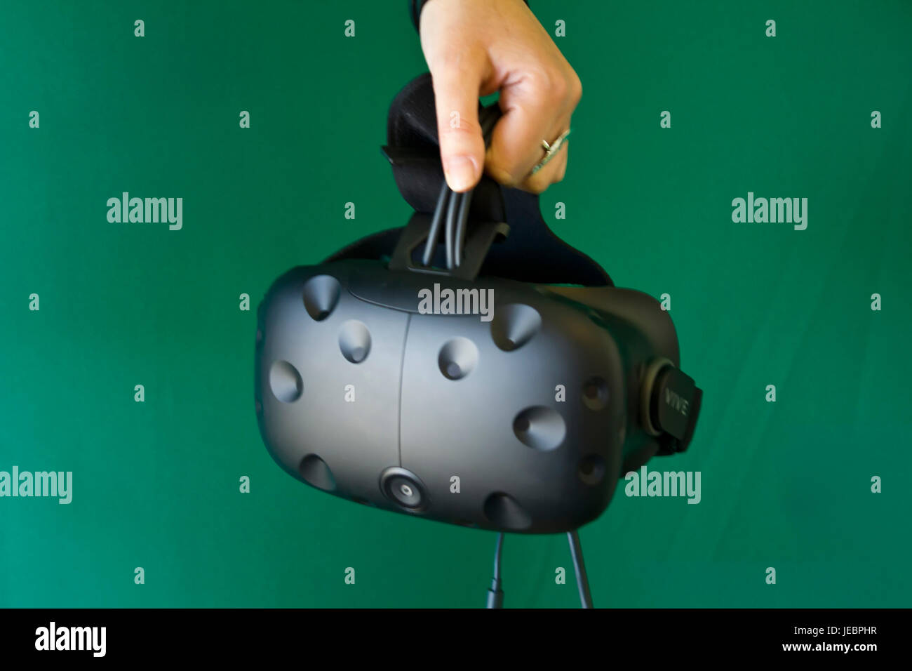Woman hand holding vr glasses - Stock Image