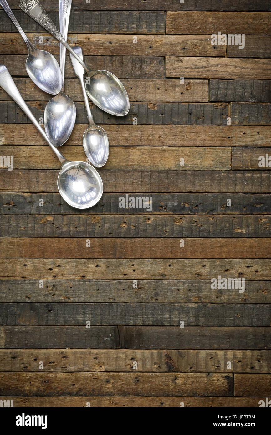 Vintage antique spoons on old wooden background flat lay food blog instagram mockup - Stock Image