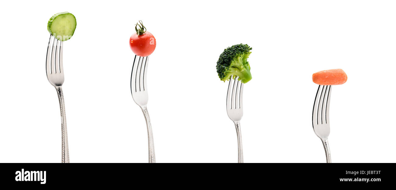 cucumber, cherry tomatoe, carrot and broccoli on forks isolated on white. healthy lifestyle concept - Stock Image