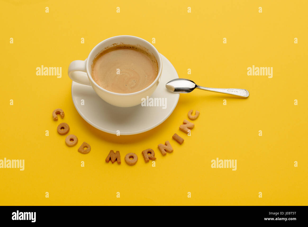 Close-up view of cup of fresh hot coffee and good morning inscription - Stock Image
