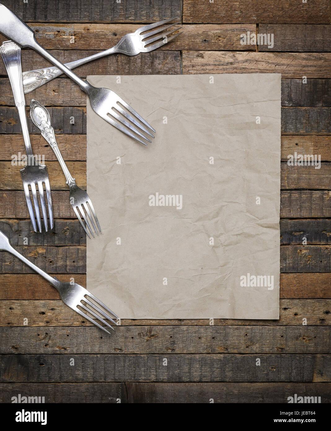 Vintage antique forks on old wooden background flat lay food blog instagram mockup - Stock Image