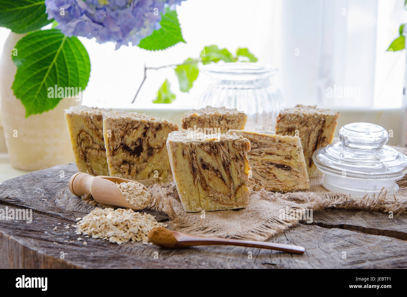homemade oats and cinnamon soap using olive oil shea and cocoa butter Stock Photo