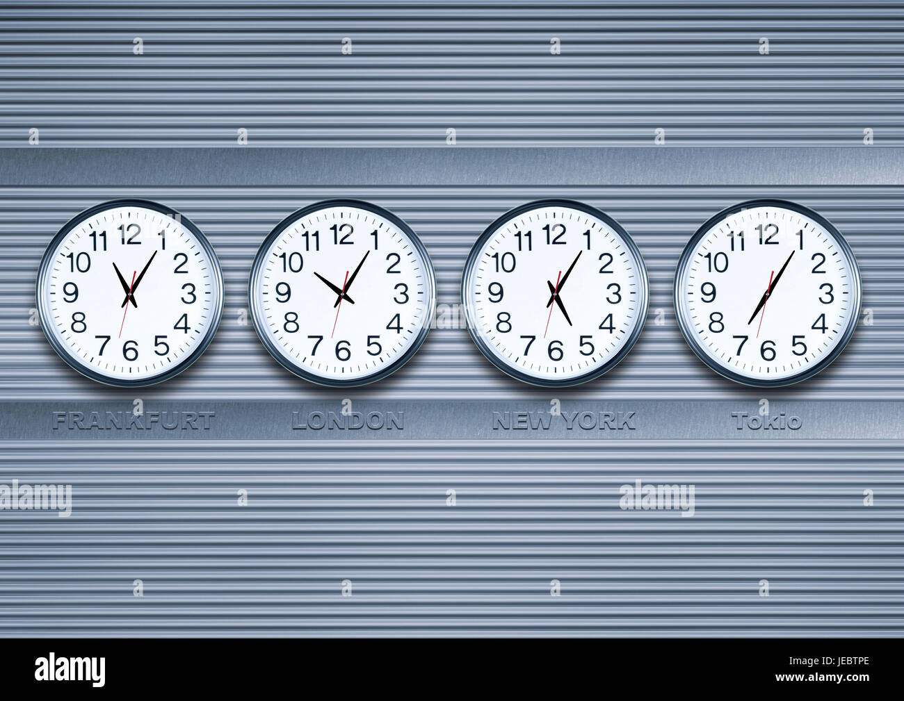 Clocks, time difference, - Stock Image