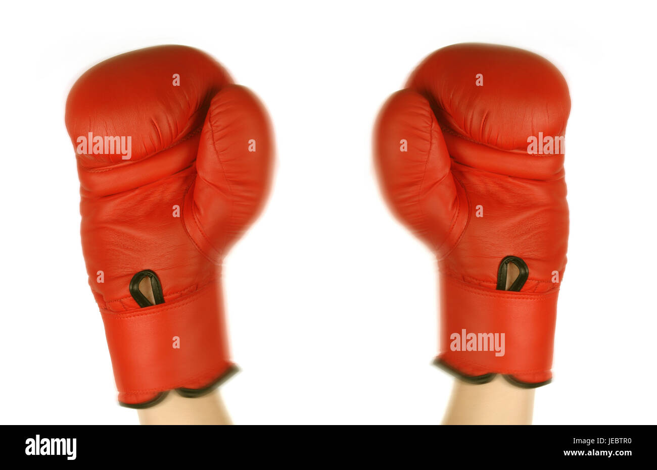 Red boxing gloves in winner's pose, - Stock Image