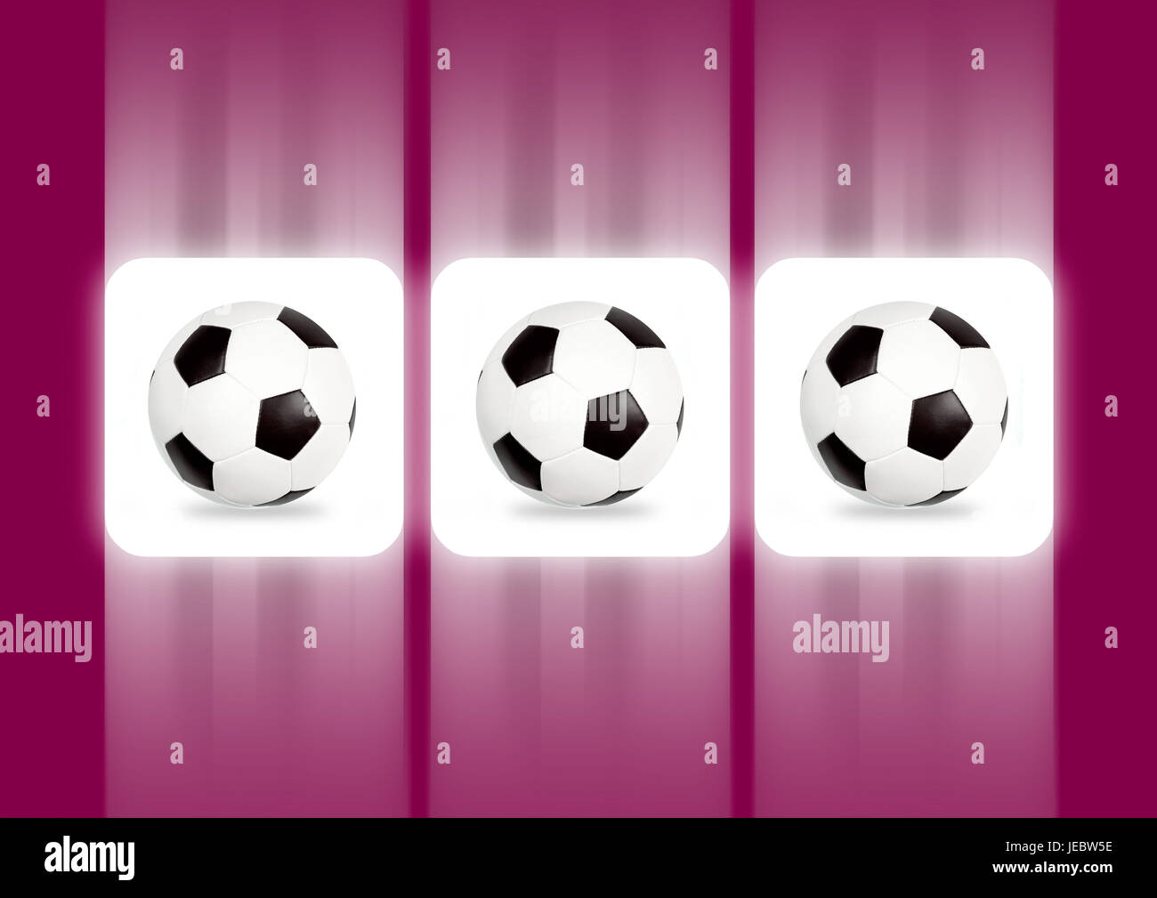 three footballs on the display of an arcade game, - Stock Image