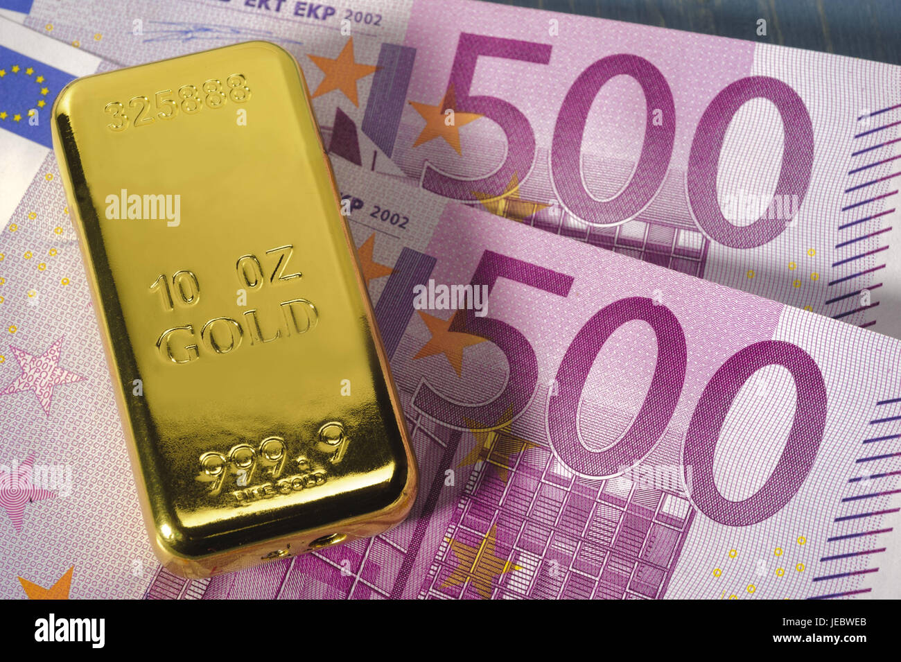 Gold bars, banknotes, golden price, bank, bank notes, cash, income, euro, euronotes, finances, money, stocks, numbers, - Stock Image