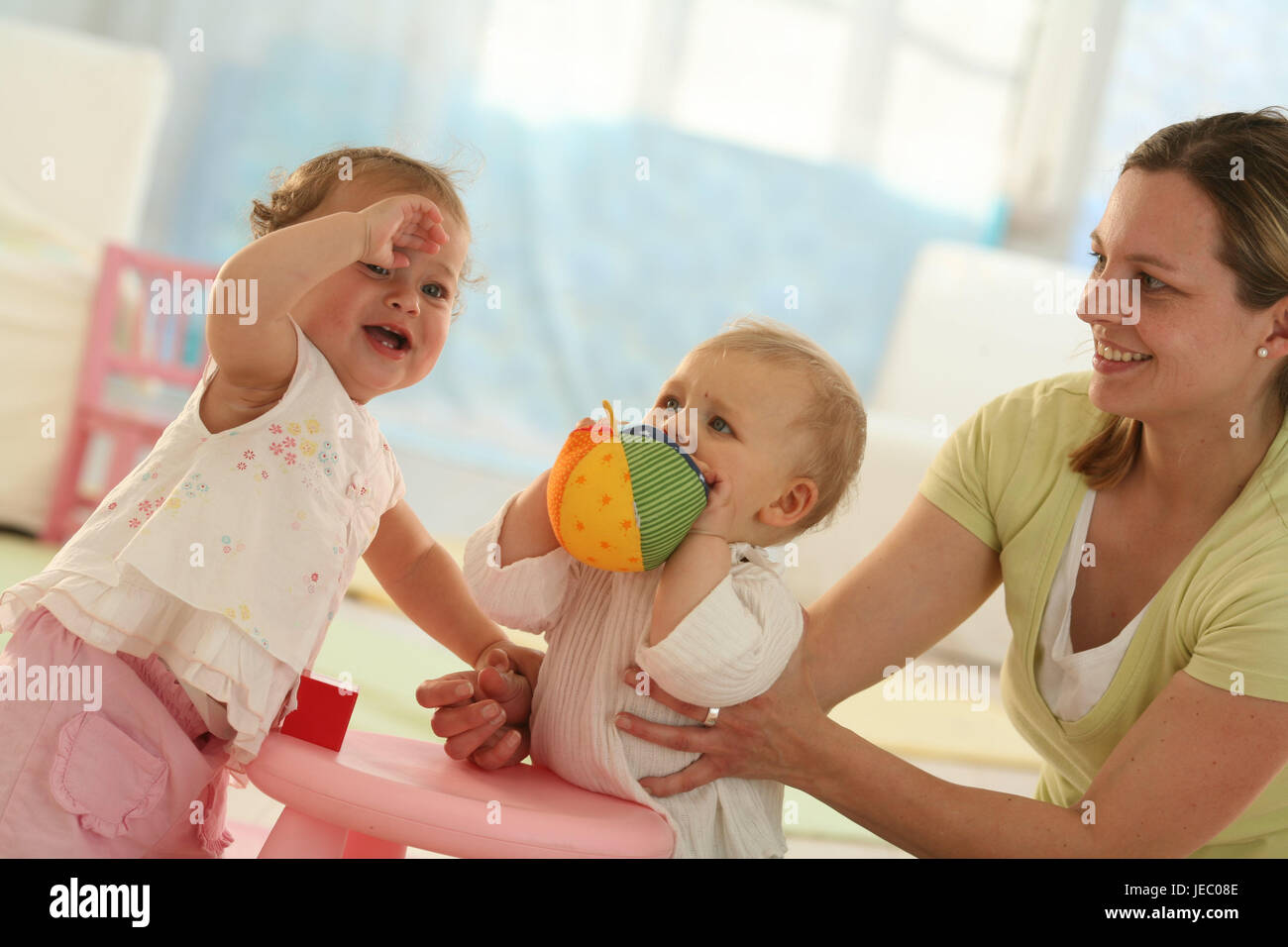 Babies, 9 months, mother, ball, play, get up, ball, dressed, blond, jealousy, discoveries, friends, reach, group, - Stock Image