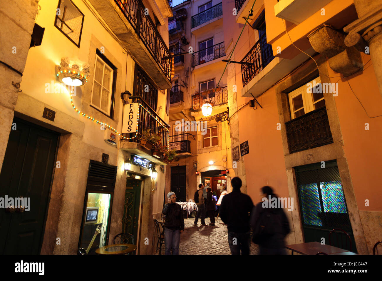 Portugal, Lisbon, Old Town, Alfama, lane, passer-by, at night, Stock Photo