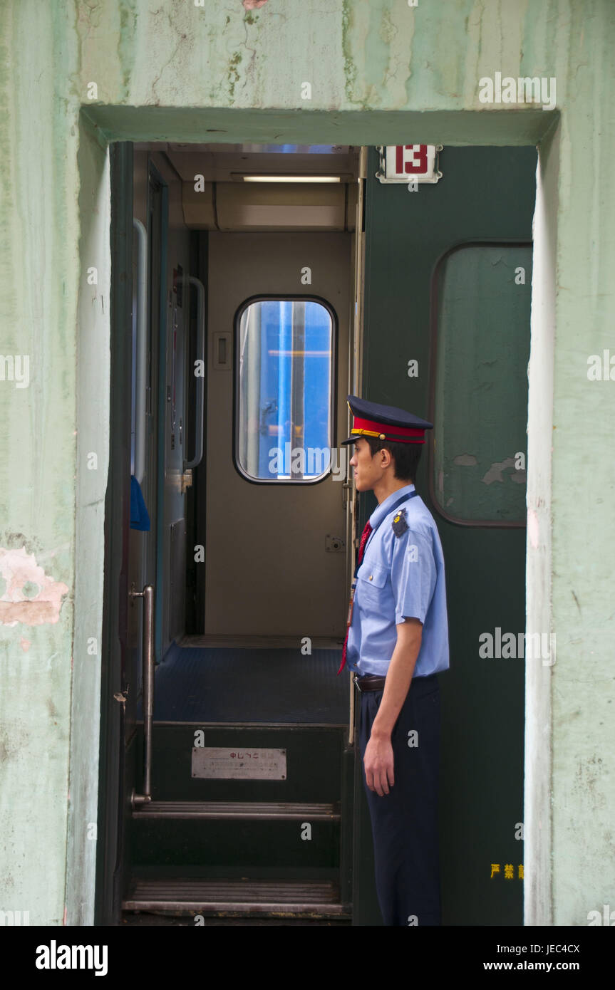 Conductor in the train of Lhasa to Chengdu, Tibet, Asia, - Stock Image