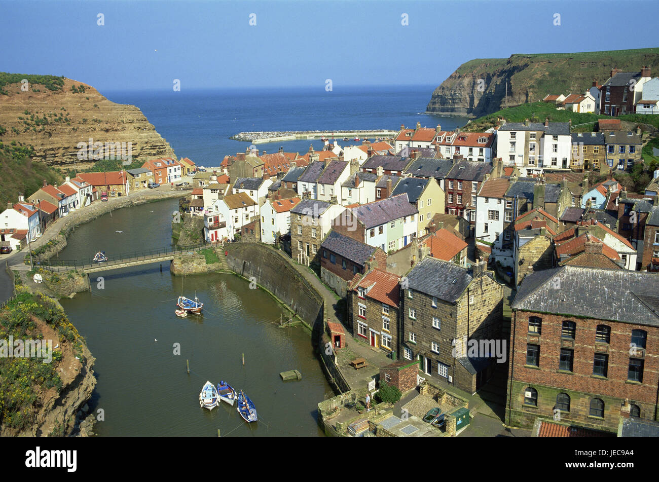 Great Britain, England, North Yorkshire, Staithes, town view, river, bridge, boats, Europe, destination, place of - Stock Image