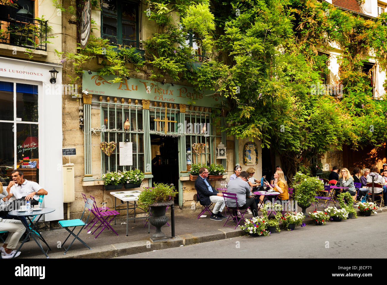 Paris, France, June 04, 2017 : Famous style of life in Paris, France with bistrrots and people on terraces. Here, - Stock Image