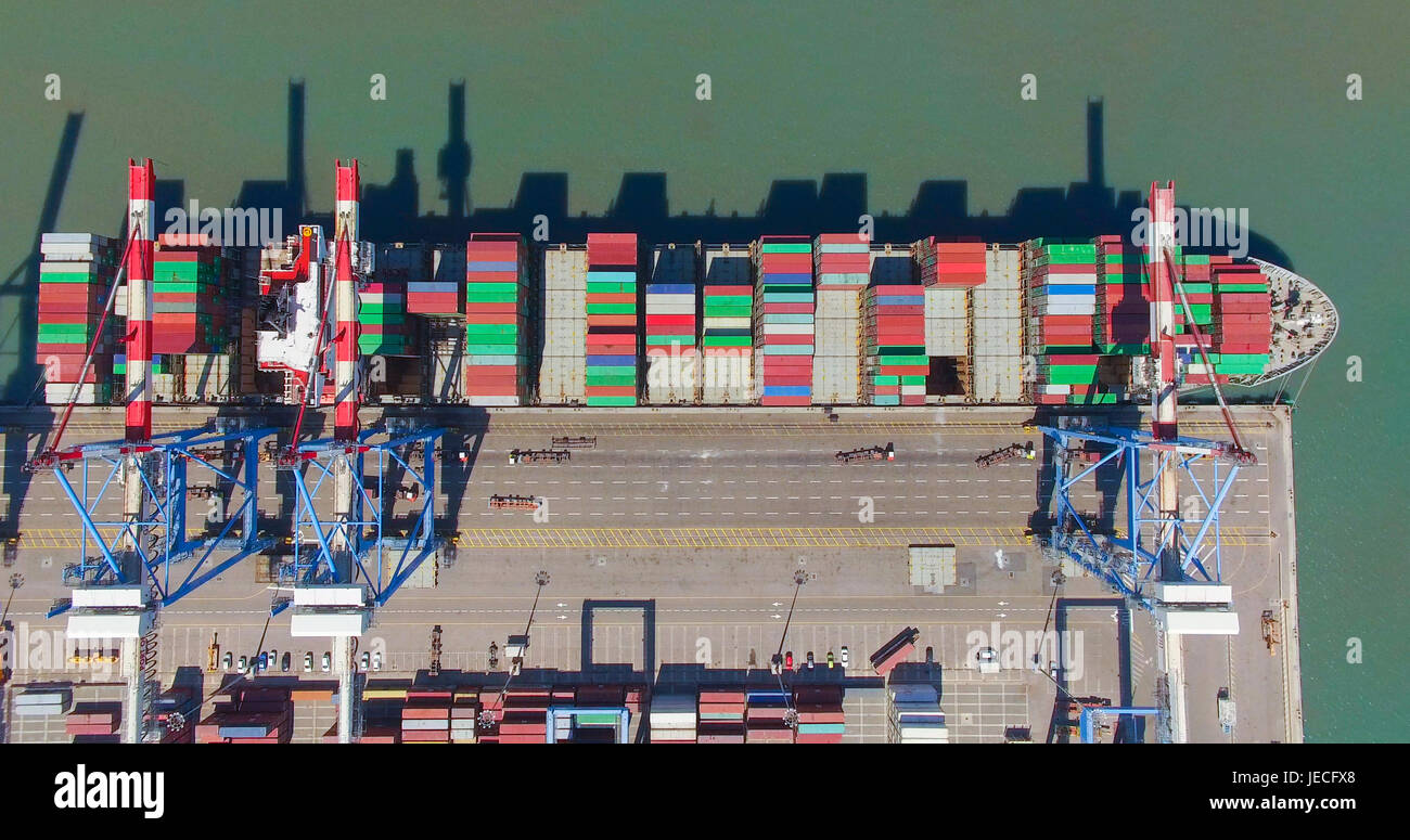 Commercial port with container ship - Top down aerial view