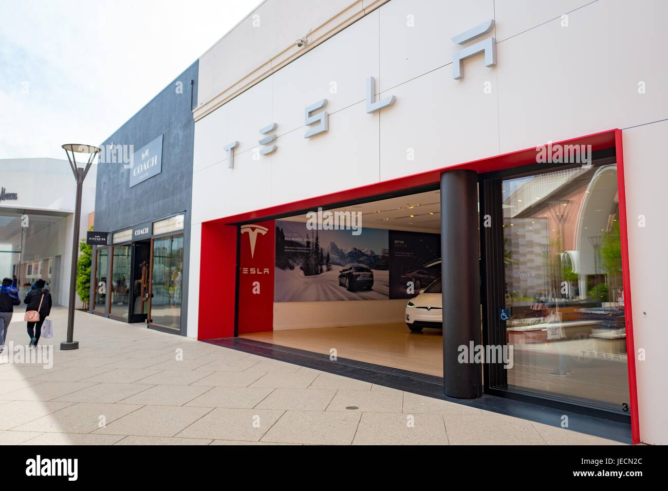 Store for automaker Tesla Motors at the Stanford Shopping Center, an upscale outdoor shopping mall in the Silicon - Stock Image