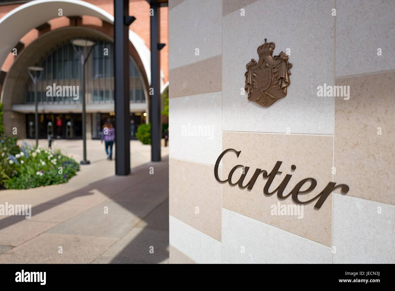 Signage for luxury clothing brand Cartier at the Stanford Shopping Center, an upscale outdoor shopping mall in the - Stock Image