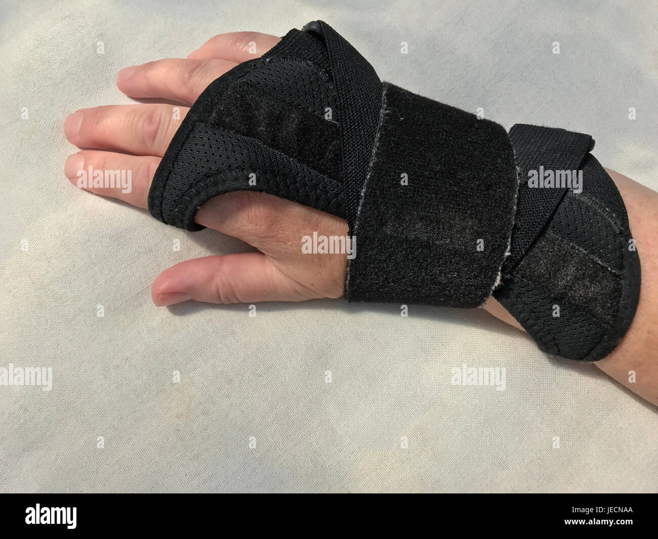 Right hand in hand cuff outside - Stock Image