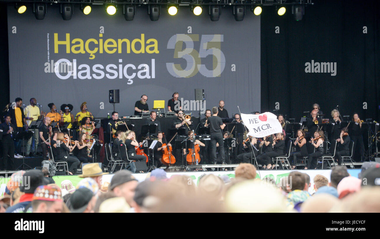A 'WE 'HEART' MCR' flag in front of the Pyramid stage, while the Hacienda Classical Orchestra opens - Stock Image