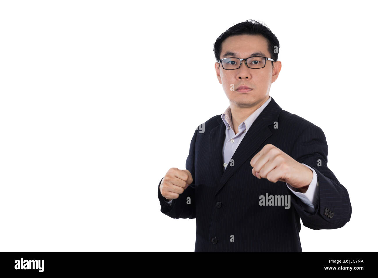 Angry Asian Chinese man wearing suit and holding both fist in isolated white background. - Stock Image