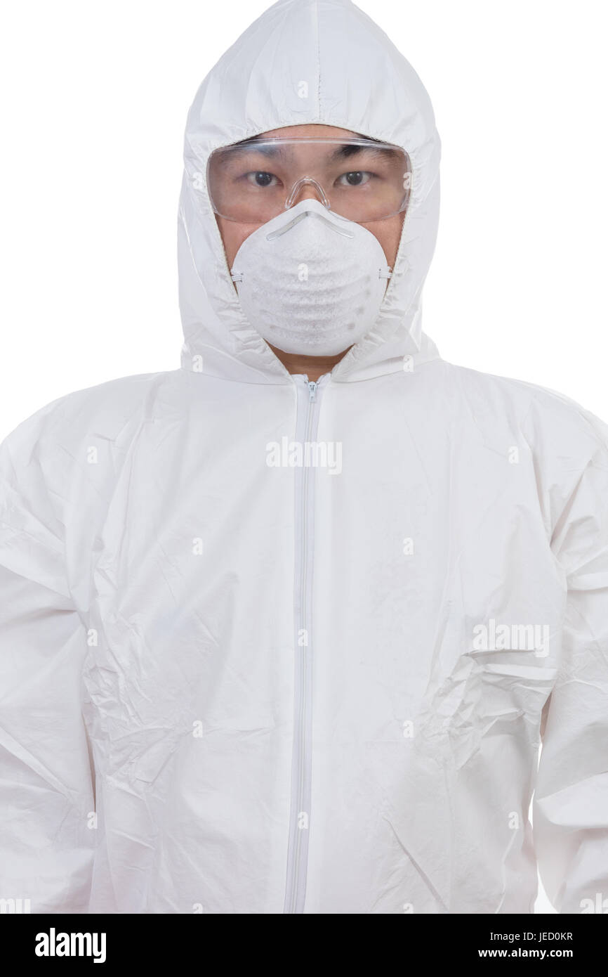 Asian Chinese scientist in protective wear with glasses and respirator in isolated white background. - Stock Image