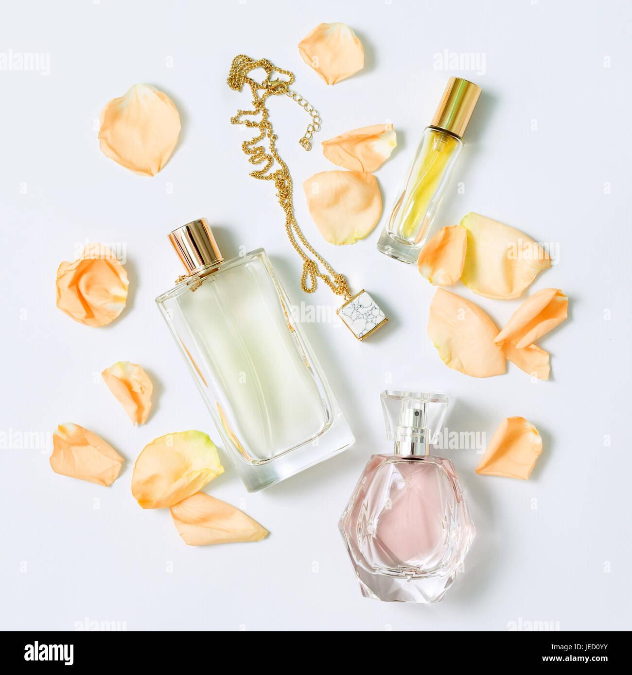 Perfume bottle flowers stock photos perfume bottle flowers stock perfume bottles with flowers petals on white background perfumery cosmetics jewelry and fragrance mightylinksfo