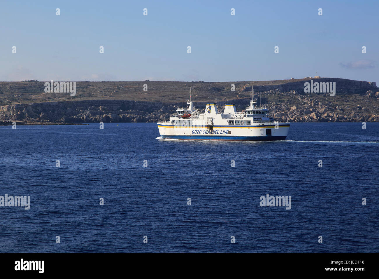 Gozo Channel Line ferry ship crossing between islands of Malta and Gozo passing Comino - Stock Image