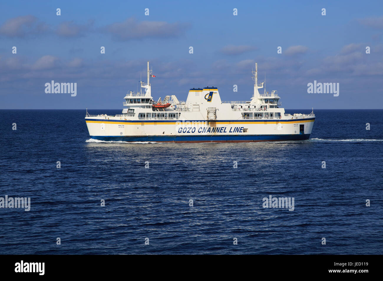 Gozo Channel Line ferry ship crossing between islands of Malta and Gozo - Stock Image