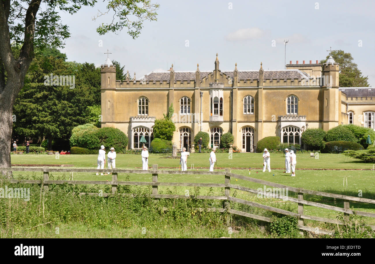 Croquet on the lawns of Missenden Abbey  Bucks - backdrop ancient Missenden Abbey mature trees sunlight blue sky - Stock Image