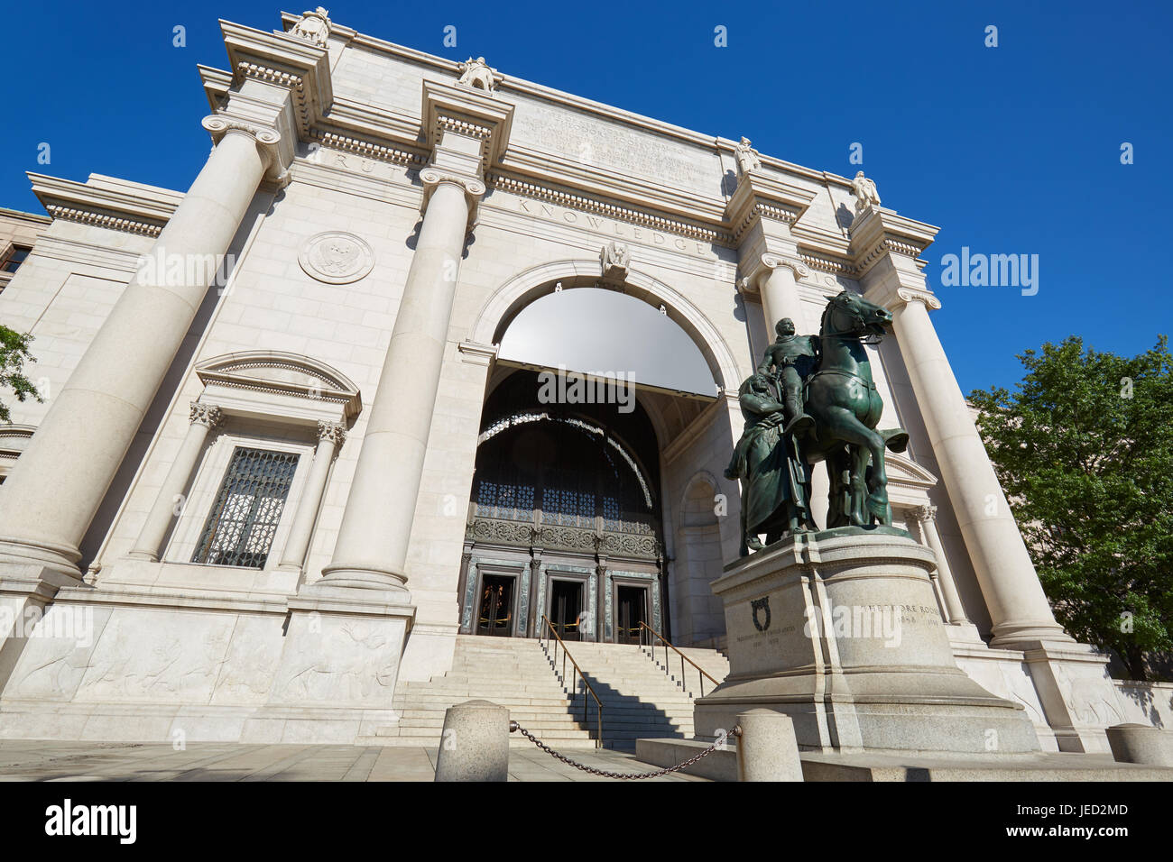 American Museum of Natural History building facade in a sunny day, blue sky in New York - Stock Image