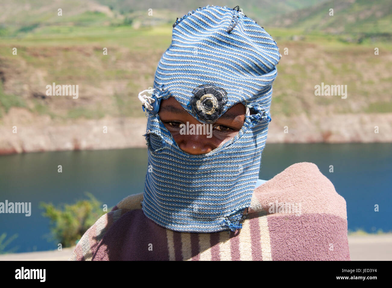 Portrait boy wearing traditional headdress Katse reservoir Lesotho Southern Africa - Stock Image