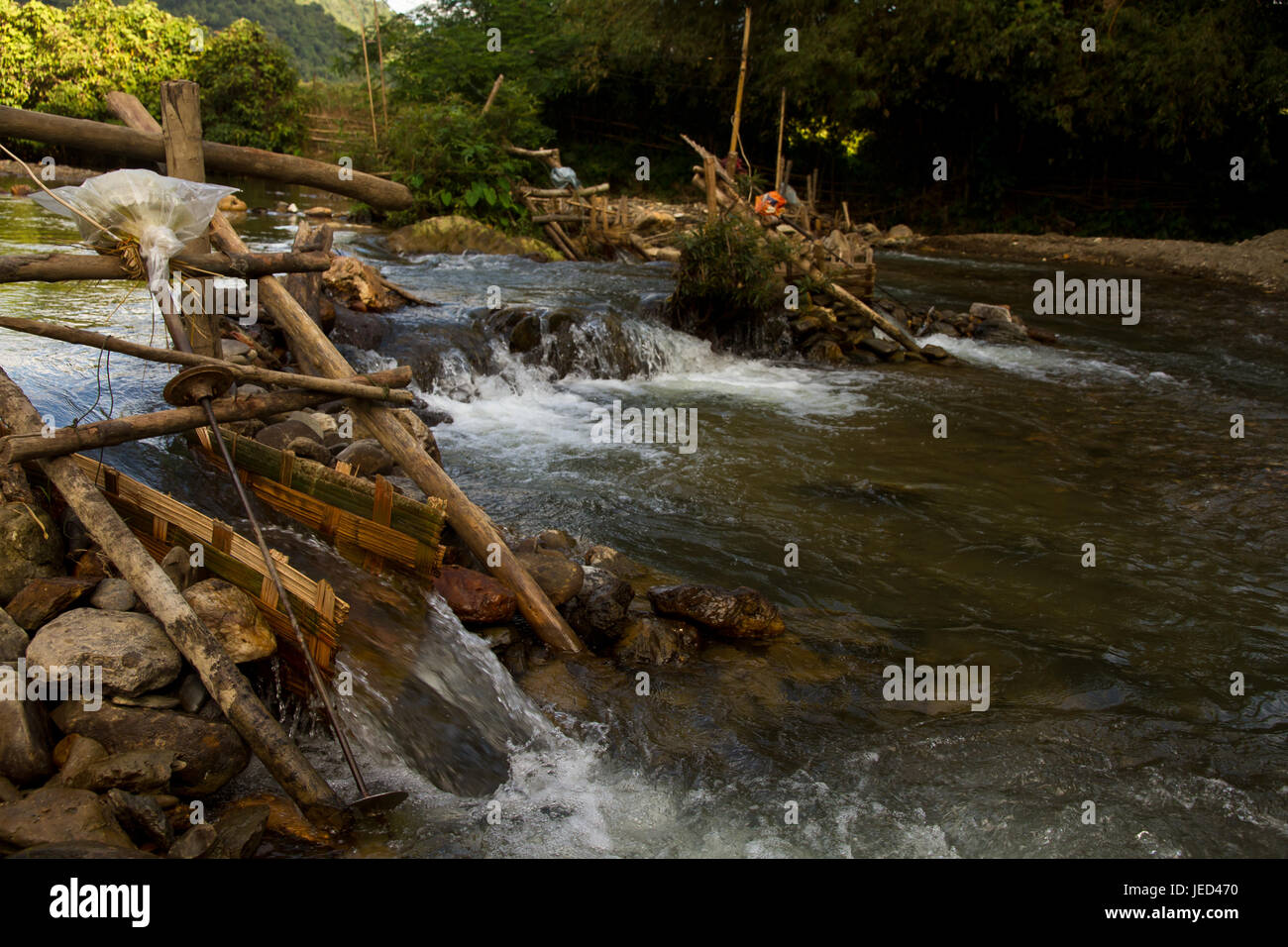 Improvised run-of-stream micro hydro electricity generation. , Laos - Stock Image